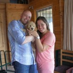 Labradoodle pup Bodey and family